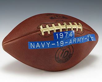 Army–Navy Game - A game ball from the 1974 Army–Navy Game, with the game's final score (Navy 19, Army 0) adhered on with a label.