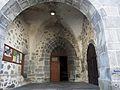 Bagnols (63) église porche.JPG