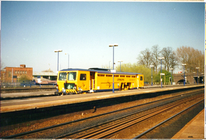 Amey plc - A picture of Amey Plc balast/track tamper train at Banbury station.