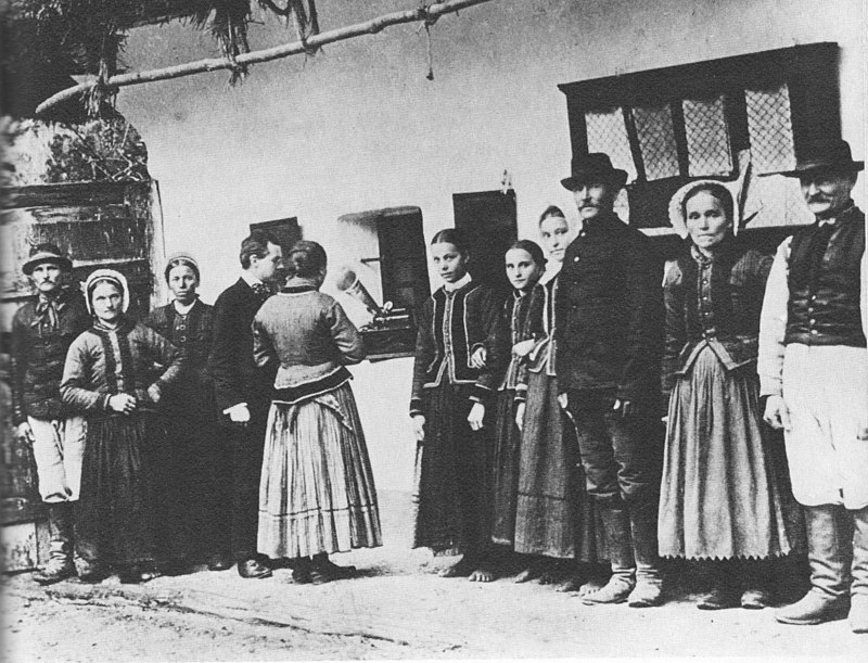 Bela Bartok using a gramaphone to record folk songs sung by Slovak peasants.