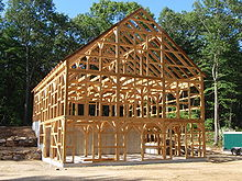 The Skeleton Of A Post And Beam Horse Barn Just After Raising