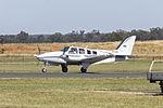 Beech 58 Baron (VH-UKL) taxiing at Temora Airport.jpg