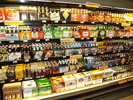 Whole Foods Market has opened wine and beer shops to cater to their upmarket brand. Above, the imported beer case at a Whole Foods beer shop. Beer at a grocery store in New York City.JPG