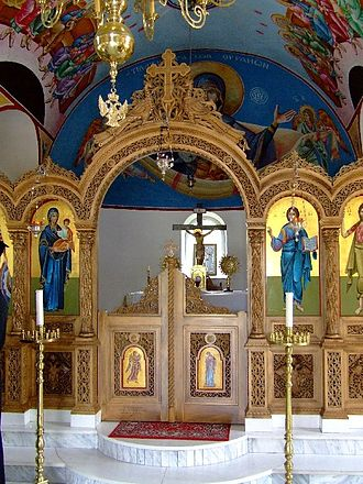 Ambon (liturgy) - An iconostasis with a rounded stone ambon of two steps (Beloiannisz, Hungary).