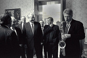 Foreign policy of the Bill Clinton administration - Clinton plays the saxophone presented to him by Russian President Boris Yeltsin at a private dinner in Russia, January 13, 1994