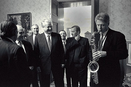 Clinton plays the saxophone presented to him by Russian president Boris Yeltsin at a private dinner in Russia, January 13, 1994 Bill Clinton and Boris Yeltsin 1994.jpg