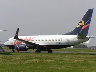 Aloha Airlines - A former Aloha Boeing 737-700WL in storage in Southend Airport, England after the airline's 2008 demise
