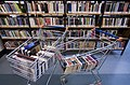 Books in a shopping cart in a library - 8459.jpg