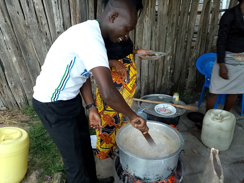File:Boy Child cooking as women oversee.jpg