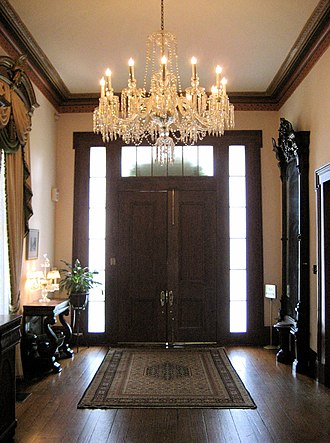 Bragg–Mitchell Mansion - The first floor hallway, looking toward the entrance doors.