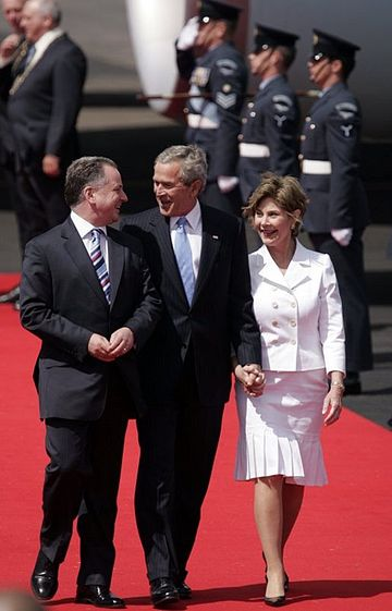 Former First Minister Jack McConnell welcomes then-President of the United States George W. Bush to Glasgow Prestwick Airport at the start of the G8 Summit in July 2005 Bush&McConnell.jpg