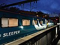 CAF mk5 sleeper coach with class 92 locomotive.jpg