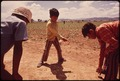 CHILDREN OF MIGRANT WORKERS PLAY MARBLES WHILE THEIR PARENTS WORK IN FIELDS. BECAUSE THEIR FAMILIES MUST CONSTANTLY... - NARA - 543859.tif