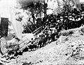 COLLECTIE TROPENMUSEUM Met een slede wordt de deksteen van een graf naar een begraafplaats bovenop de heuvel gesleept West-Sumba TMnr 10003260.jpg