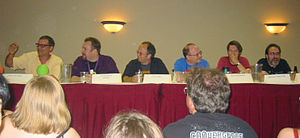 CONvergence - A panel of experts (including cartoonist John Kovalic, far left, and author Brian Keene, far right), debate who would win in a fight: Frankenstein's Monster or Cookie Monster.
