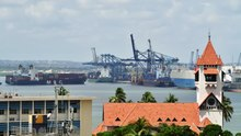 File:Cargo ship disembark at the port.webm