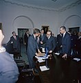 Carlos Manuel Muñiz presents a gift of a vicuña poncho to President Kennedy.jpg