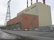 Picture of the generating station taken from route 132. A tall building with an even taller electric pylon on the right.