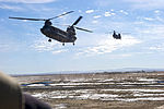 Chinooks coming in to pick up the team 120127-A-UU828-370.jpg
