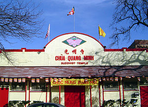 Flag of South Vietnam - A South Vietnamese flag being flown over a Buddhist temple in the U.S. state of Illinois, alongside the U.S. flag.
