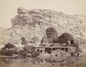 Kappe Arabhatta - 1880s photograph of cliff overlooking the Bhutanatha temple on the eastern end of the artificial lake in Badami.  The Kappe Arabhatta inscription is carved on a cliff overlooking the northeast end.