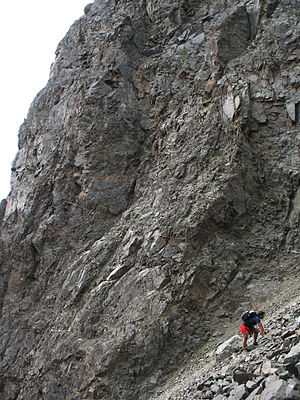 Bold Peak - A hiker ascends the Stiver's Gully route on Bold Peak.