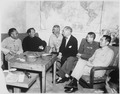 Conference at Yenan Communist Headquarters before Mao Tze Tung, chairman, left for Chungking meeting. Central figures... - NARA - 531400.tif