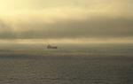 Container Ship below fog. (2897397878).jpg