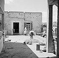 Daliya al-Carmel. Dorpsgezicht een druzische vrouw en een ezel op een pleintje, Bestanddeelnr 255-2671.jpg