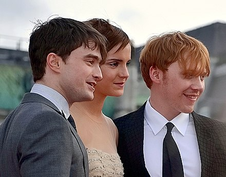 Watson with Daniel Radcliffe (left) and Rupert Grint at the London premiere of Deathly Hallows - Part 2 in July 2011 Daniel Radcliffe, Emma Watson & Rupert Grint colour.jpg