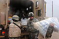 Defense.gov News Photo 100328-N-5330L-044 - A U.S. Army soldier from Alpha Company 1st Battalion 30th Infantry Regiment 2nd Brigade Combat Team 3rd Infantry Division hands bags of.jpg