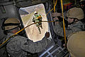 Defense.gov News Photo 110512-F-DP668-499 - U.S. Air Force airmen jump from a C-17 Globemaster III aircraft during a certification course for drop zone control officers in Alamo Nev. on May.jpg