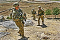 Defense.gov News Photo 110615-A-2911M-678 - U.S. Army 1st Lt. John Dundee left leads a group of soldiers from the town of Gomerai back to Combat Outpost Najil in Laghman province.jpg