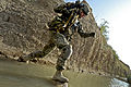 Defense.gov News Photo 110709-F-FT240-140 - U.S. Army Sgt. 1st Class Robert Russell crosses the Tarnek River in Qalat City Afghanistan on July 9 2011. Russell a platoon sergeant is a.jpg