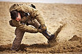 Defense.gov News Photo 120212-M-MM918-007 - U.S. Marine Lance Cpl. David Manning digs a foxhole at his platoon s defensive position during Operation Shahem Tofan Eagle Storm in the Garmsir.jpg