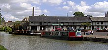 Water with two narrow boats and bridge