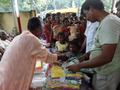 Dress Distribution at barakashipur Durga puja mandop.png