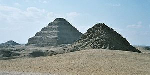Saqqara - View of Saqqara necropolis, including Djoser's step pyramid (centre), the Pyramid of Unas (left) and the Pyramid of Userkaf (right).