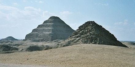 View of Saqqara necropolis, including Djoser's step pyramid (centre), the Pyramid of Unas (left) and the Pyramid of Userkaf (right) Egypt.Saqqara.Panorama.01.jpg