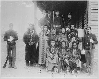 "Crow Nation - ""Eight Crow prisoners under guard at Crow agency, Montana, 1887"""