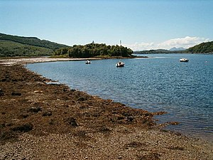 Loch Sween -  The tidal islet of Eilean Mhartan in the inner loch, with the Paps of Jura in the distance