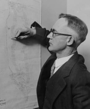 Elmer Drew Merrill - Elmer Drew Merrill examines map of California Botanic Gardens