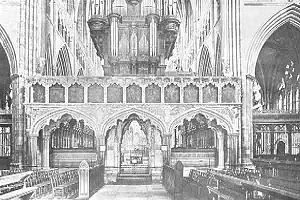 Pulpitum - The pulpitum in Exeter Cathedral, Devon, England, photographed in the early 20th century, The interior of the pulpitum was opened up in a 19th-century reconstruction, so as to provide worshippers with a view of the high altar; originally it was solid