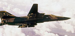 F-111A 428th TFS in flight with cluster bombs.jpg