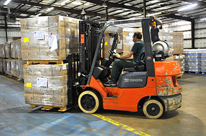 Distribution center - A fork lift truck moves stacked pallets