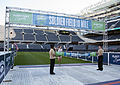 FHCC Sailors present finishing medals at Soldier Field 10 Mile 140524-N-ME988-123.jpg