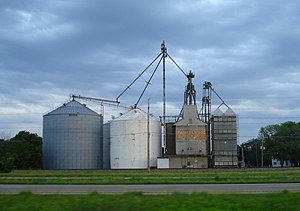 "The Lawndale grain elevator (with old ""Faultless Feed"" sign) is the most visible building."