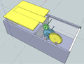 Feeder box with gear components.png