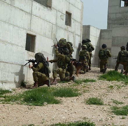 Israeli soldiers of the Kfir Brigade during an exercise simulating the takeover of a hostile urban area. Flickr - Israel Defense Forces - Kfir Brigade IDF Officers Practice Urban Warfare (1).jpg