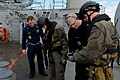 Flickr - Official U.S. Navy Imagery - U.S. Sailors check the weapons of the Danish visit, board, search and seizure team before they begin a boarding scenario..jpg